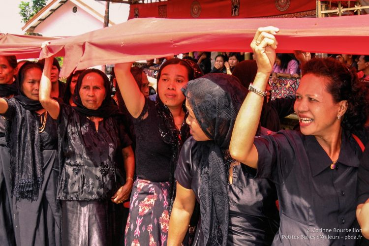 The procession of women, all in black.