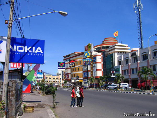 "The ""Mega Mall"" of Manado. All around, shopping malls and billboards for well-known brands ... Nord-Sulawesi, Indonesia, July 2007."