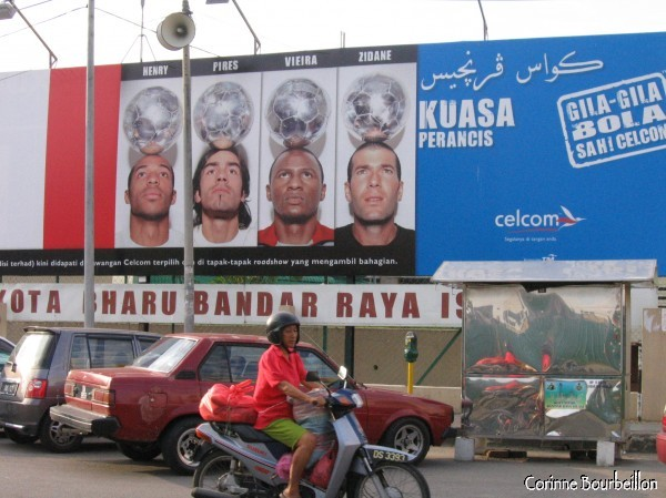 The Blues are advertising for a mobile operator in the streets of Kota Bahru. (Malaysia, July 2006)