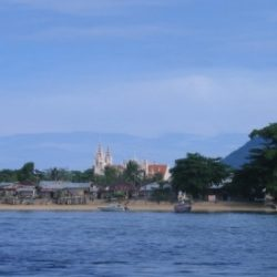The island of Bunaken seen from the sea. Here the town church located near Pantai Pangalisang (East Coast Beach).