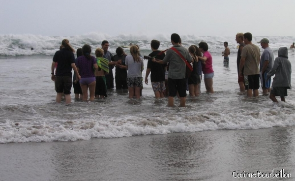 "Baptism in the sea on the beach of Kuta in Bali, by the ""Followers of Jesus""."