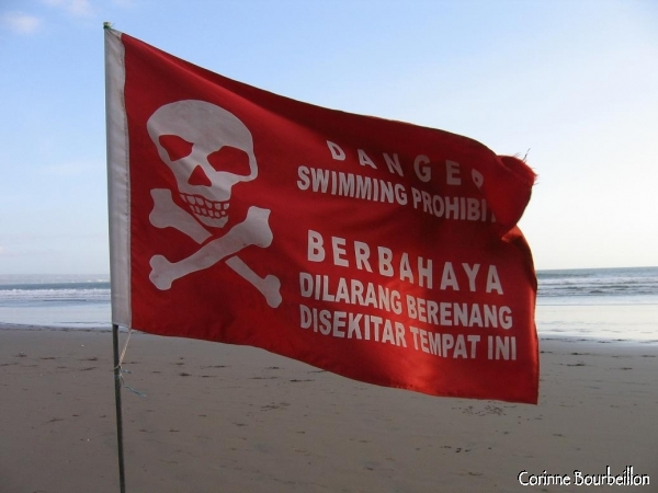 Along Bali's Kuta Beach, red flags remind you that the sea is dangerous.
