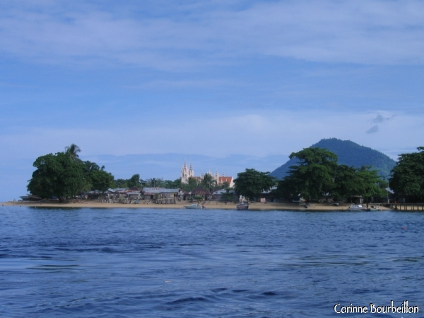 From the sea, we can see the Pantai Pangalisang church. (Bunaken, North Sulawesi, Indonesia, July 2007.)