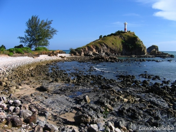 South of Koh Lanta, a lighthouse, beaten by the wind and waves ...