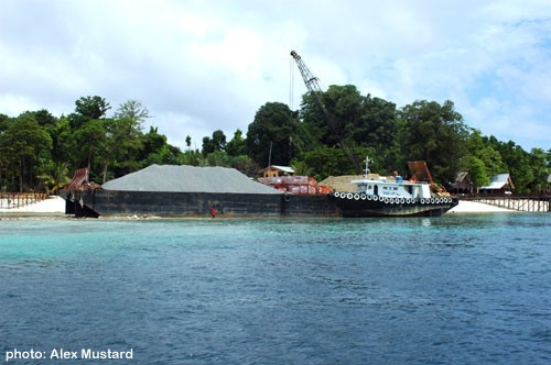 A barge on the reefs of Sipadan. May 2006. Photo: Alex Mustard.