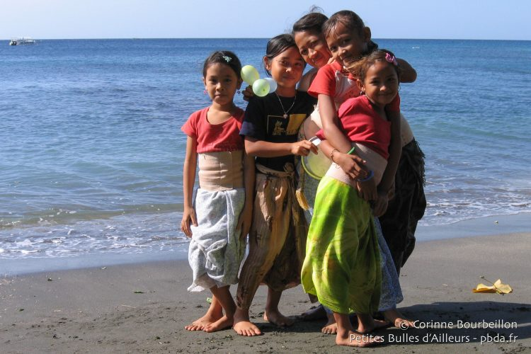 On the beach of Pemuteran, little girls play after their traditional dance class. (Bali, Indonesia, July 2008)