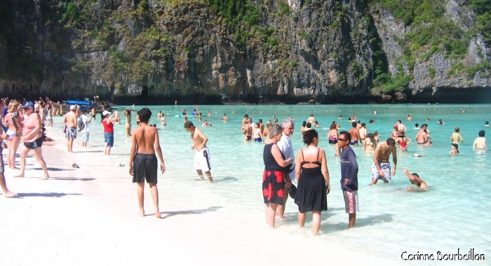 "In the late morning, tourists invade Maya Beach on the island of Koh Phi Phi Leh in Thailand. This is where the film ""The Beach"" was shot with Bernardo Di Caprio and Virginie Ledoyen."
