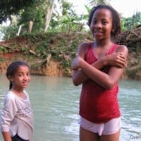 Swimming in the cool waters of a river near Las Terrenas.