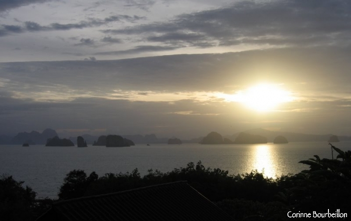 In the morning, I admire the sunrise from the terrace of my bungalow. Koh Yao Noi, Thailand. February 2009.