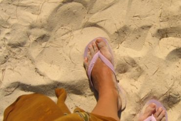 Feet in the sand. Paradise Beach, Perhentian Kecil, Malaysia. July 2009.