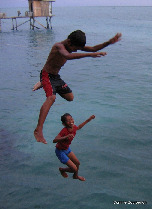 The children of Mabul have fun jumping from the top of the pontoon. Malaysia, July 2009.
