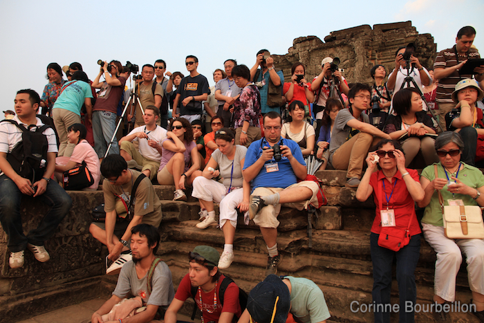 The crowd of tourists is waiting for sunset on the Bakheng Hill temple. Siem Reap, Cambodia. February 2011.