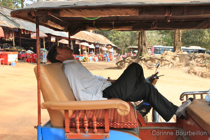 Our tuk-tuk driver takes a nap while we visit the temples ... Cambodia, February 2011.