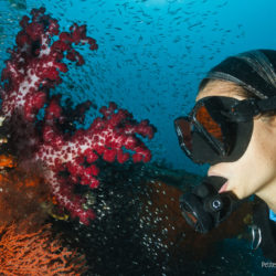 Miyo, fascinated by the life of the coral reef. Raja Ampat, West Papua, Indonesia, March 2012.