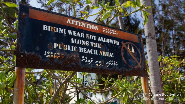 On the public beach of Hulumale, the residential island near Malé airport, it is forbidden to wear a bikini. Maldives, February 2014.