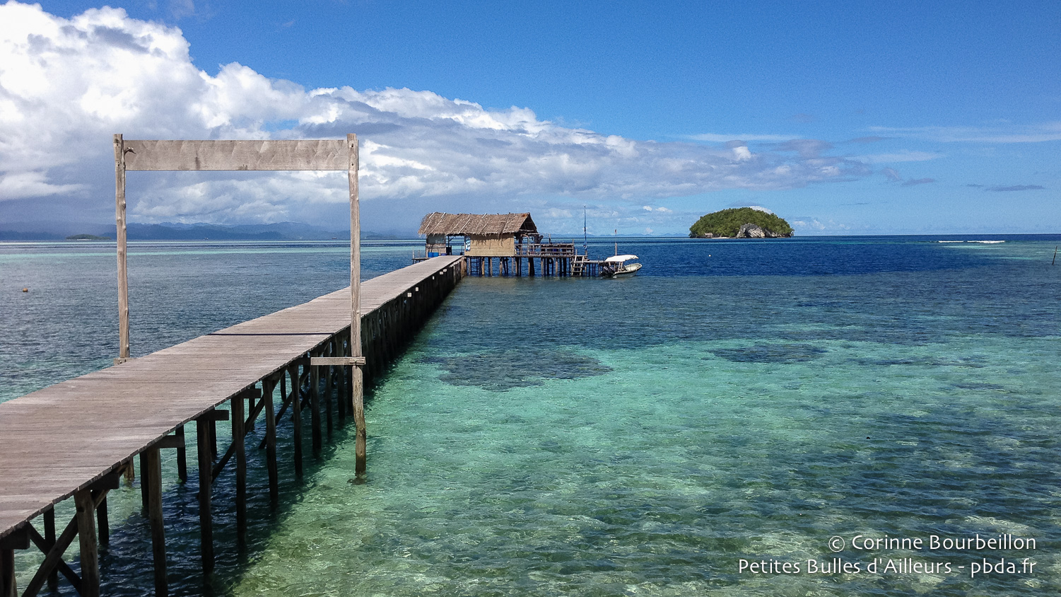The pontoon of Sorido Bay Resort and its blue hole in the middle of the coral. Raja Ampat, West Papua, Indonesia, January 2015.