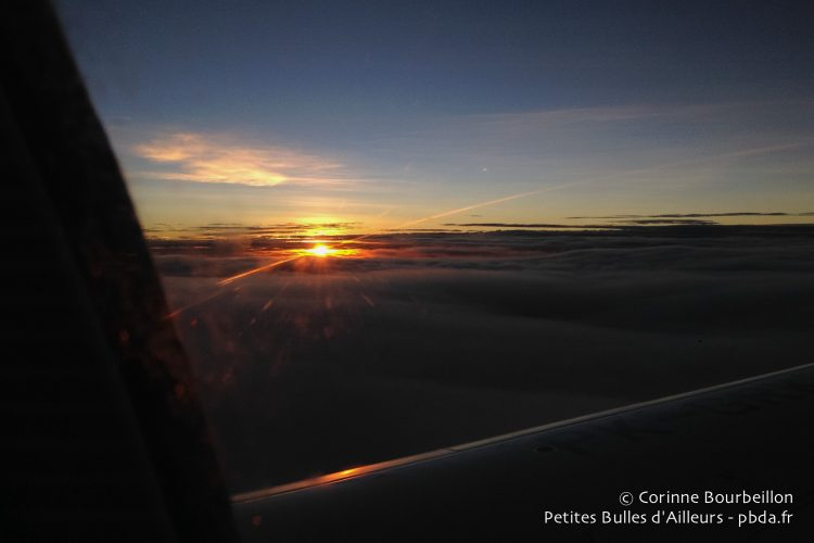 Dawn seen from the sky over Papua. January 2015.