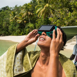 Andi, one of our guides, observes the eclipse. (Triton Bay, Papua, Indonesia, March 2016)