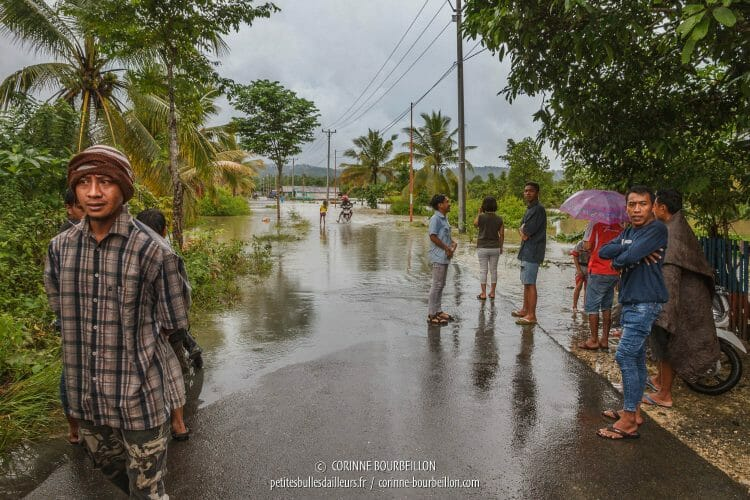 Only motorcycles and pedestrians pass. The road is cut off by floods. (Sulawesi, Indonesia, July 2017)