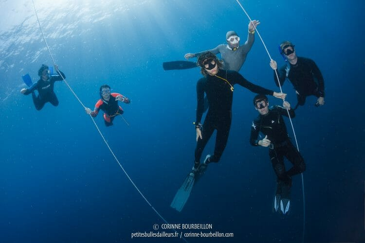 Apprentice freedivers this time down at the same time for the group photo under water! (Komodo, Indonesia, July 2016)