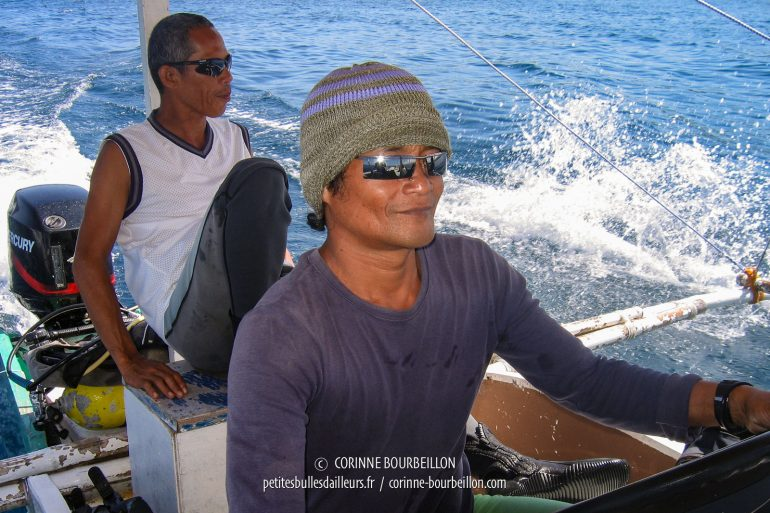 Felix, the captain, at the rudder of the banca, and Neal, our diving guide. (Siquijor, Philippines, February 2008)