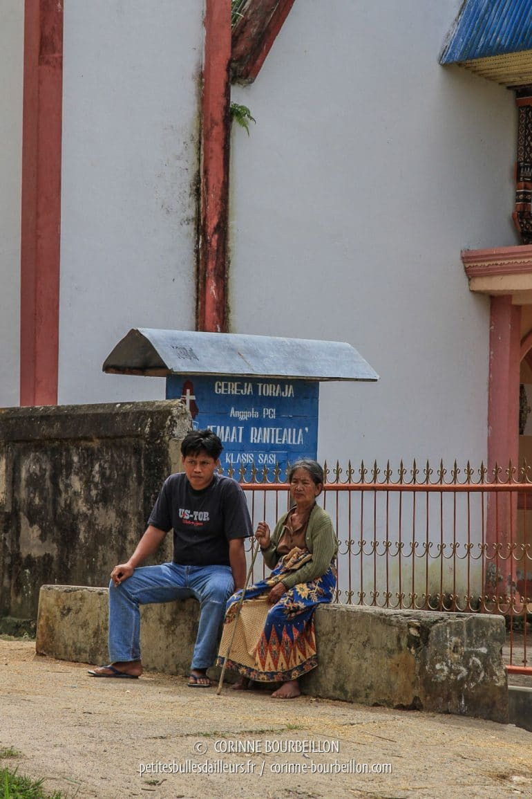 Sitting in front of the church, a man and an elderly woman, whom I suppose to be his mother. (Toraja Country, Sulawesi, Indonesia, July 2010)