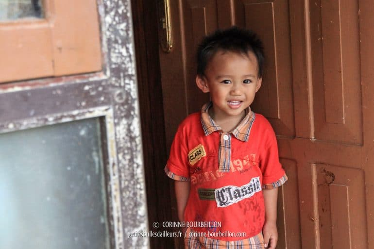 I am greeted by the children's astonished smiles. (Toraja Country, Sulawesi, Indonesia, July 2010)
