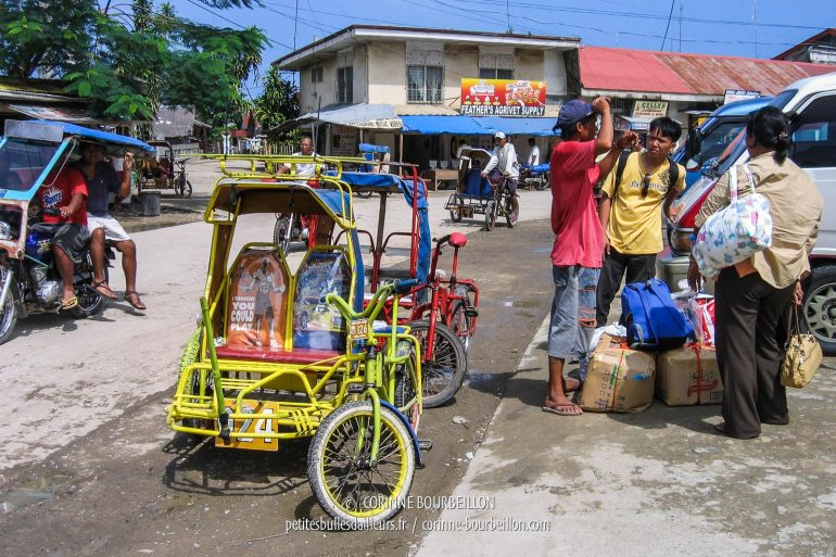 "The bicycle tricycles (pronounced ""traille-ci-keule"", in English) wait for the customer at the terminal of Ubay, port located north of Bohol. (Visayas, Philippines, February 2008)"