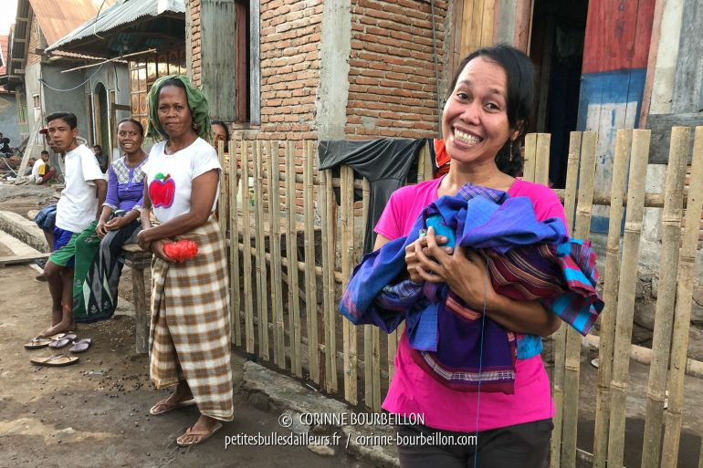 This young woman from the neighboring village, with a bright smile, works for the resort. We entrusted her with pieces of traditional cloth that we bought near Sape, which she sewed into sarong. (Sumbawa, Indonesia, July 2018)
