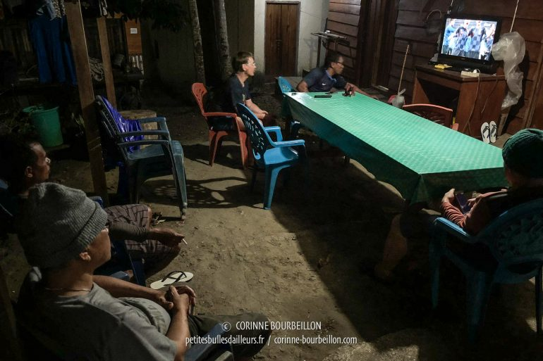 23:30 ... Only five soccer fans at Sali Bay Resort, ready to watch after midnight to watch the World Cup final on the night of July 15-16. (Halmahera, Indonesia, 2018)