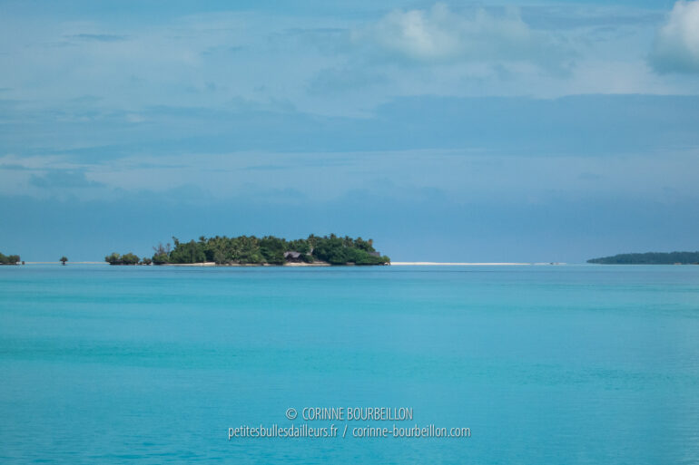 A white sandbank, as if resting on the turquoise horizon of the waters of Maratua. (Borneo, Indonesia, July 2013)