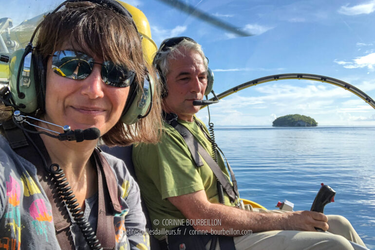 """Alongside Max Ammer in a """"pocket"""" Bell chopper he managed to have built on site, on Kri Island. (Raja Ampat, West Papua, December 2018)"""