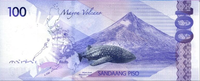 Depuis 2010, les billets de 100pesos philippins (moins de 2€) arborent au verso un requin-baleine. (Source: bsp.gov.ph)